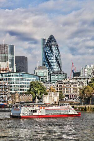 steel building: Modern London cityscape with boat, London, UK