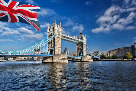 Famous Tower Bridge with flag of England in London, UK Stok Fotoğraf