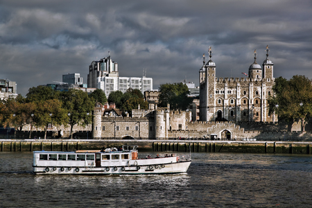 towers: Tower Hill London with old castle against boat in England, UK