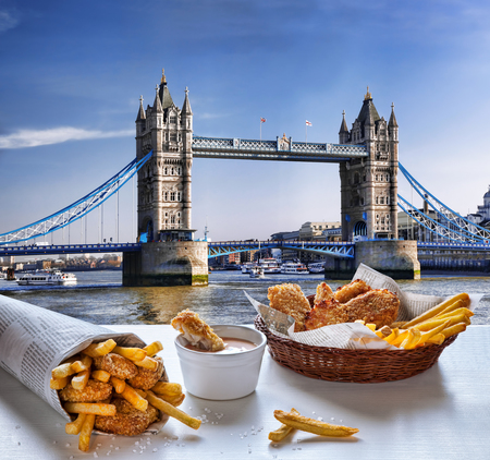 uk cuisine: Fish and Chips against Tower Bridge in London, England