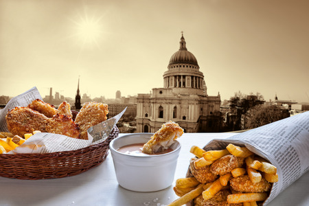 uk cuisine: Fish and Chips against St. Pauls Cathedral in London.