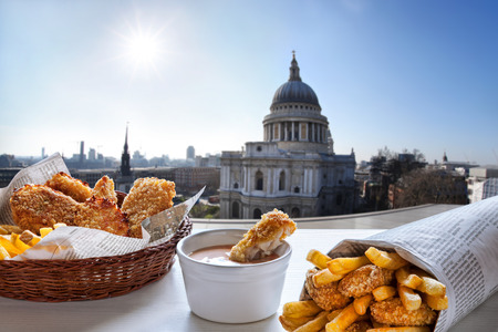 englishman: Fish and Chips against St. Pauls Cathedral in London.