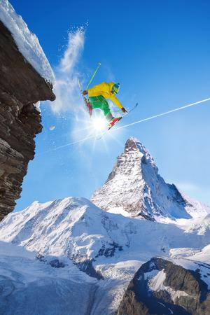 skier jumping: Skier jumping against Matterhorn in Switzerland