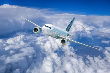 jetliner: Airplane in the sky against cloudy Stock Photo