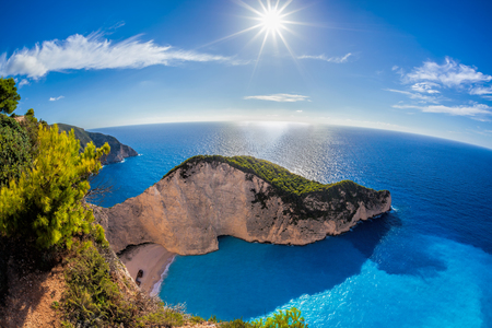 Navagio beach with shipwreck against sunset, Zakynthos island, Greece