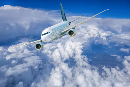 corporate airplane: Airplane in the sky against cloudy Stock Photo
