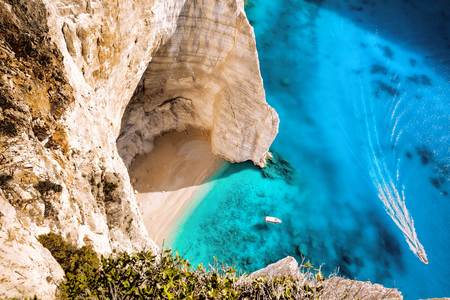 High cliff with boats on Zakynthos island in Greece