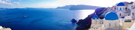 santorini greece: Panorama of Oia village on Santorini island in Greece Stock Photo