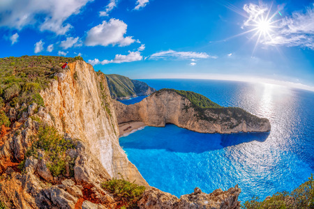 ships at sea: Navagio beach with shipwreck against sunset on Zakynthos island in Greece