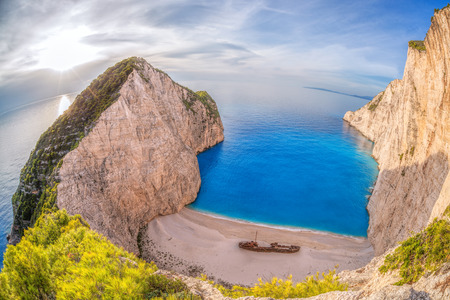 landscape flowers: Navagio beach with shipwreck against sunset on Zakynthos island in Greece