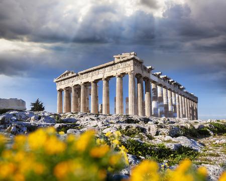 Parthenon temple with spring flowers on the Acropolis in Athens, Greece Stock Photo