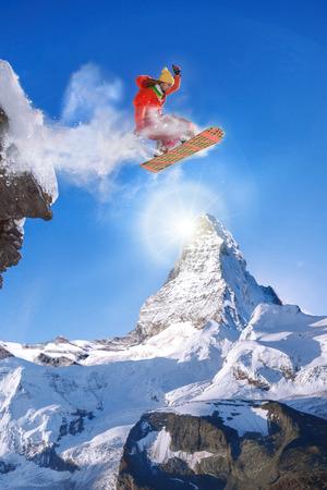 Snowboarder jumping against Matterhorn peak in Switzerland Reklamní fotografie