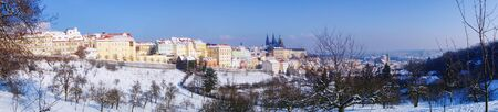 city landscape: Snowy Prague gothic Castle in Czech Republic Stock Photo