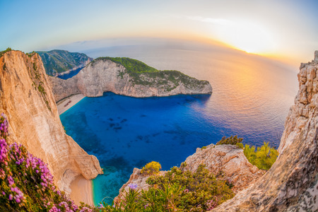 greece: Navagio beach with shipwreck against sunset on Zakynthos island in Greece