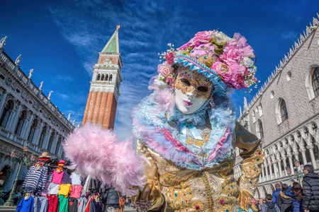 Carnival mask on San Marco square in Venice, Italy Stock Photo