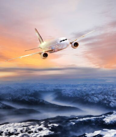 air plane: Airplane in the sky over winter Alps at amazing colorful sunset