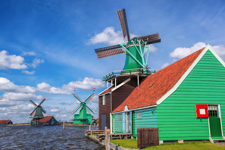 dutch typical: Traditional Dutch windmills with canal close the Amsterdam, Holland Stock Photo