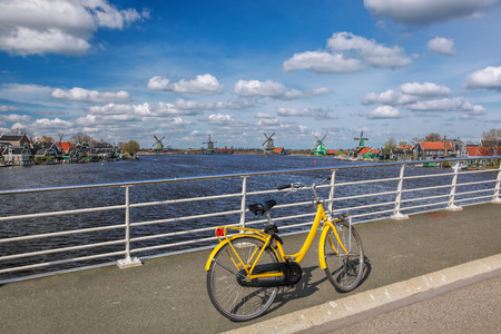 wind mills: Bicycle on the bridge in Amsterdam area, Holland Stock Photo