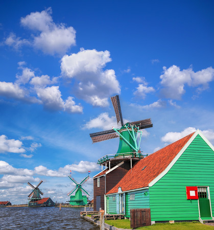 zaandam: Traditional Dutch windmills with canal close the Amsterdam, Holland Stock Photo