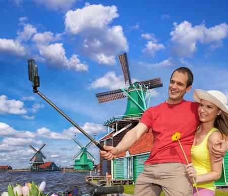 Selfie against canal with windmills in Zaanse Schans, Holland