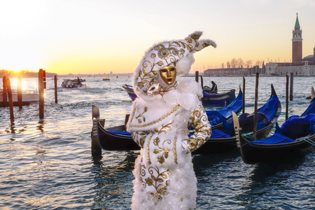elegant party: Amazing carnival mask against gondolas in Venice, Italy Stock Photo