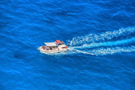 boat motor: Motor boat on open azure sea Stock Photo