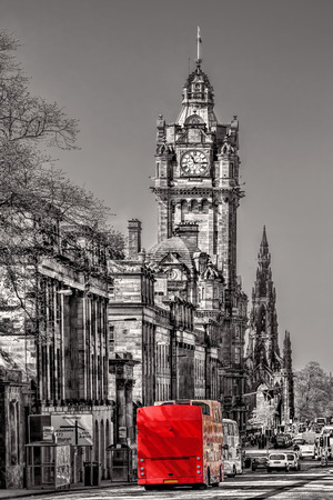 lothian: Edinburgh with red bus against clocktower in Scotland, UK Editorial