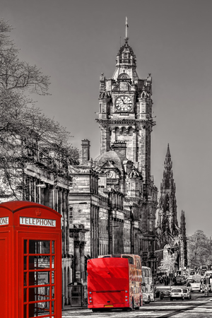 clocktower: Edinburgh with phone booths and red bus against clocktower in Scotland, UK Editorial
