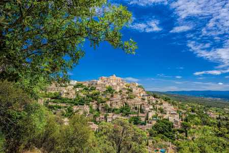 gordes: Famous old village Gordes in Provence against sunset in France