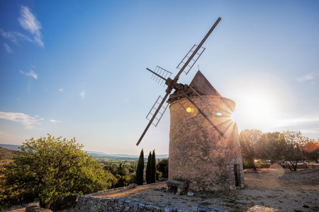 avignon: Old stone windmill against sunset in Saint Saturnin les Apt, Provence, France