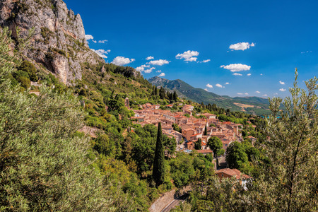 Moustiers Sainte Marie village with rocks in Provence, France Stock Photo