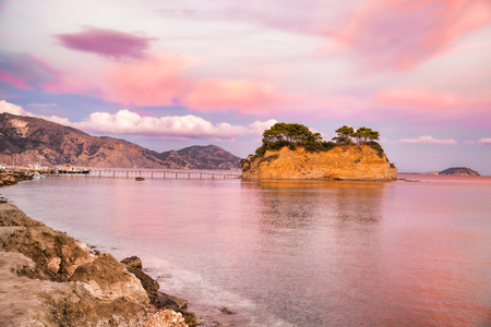 Sunset over the bridge to Agios Sostis island on Zakynthos in Greece Stock Photo