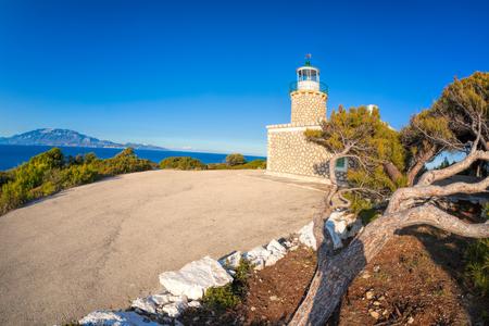 ionio: Skinari Lighthouse against Kefalonia island on Zakynthos island, Greece