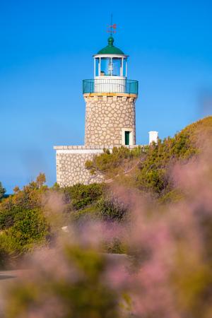 Skinari Lighthouse against Kefalonia island on Zakynthos island, Greece