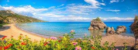 ionian: Panorama of Porto Zorro beach against colorful flowers on Zakynthos island, Greece