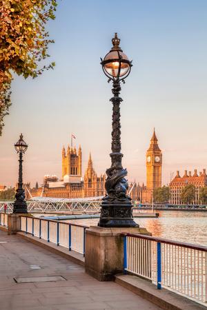 england politics: Big Ben with autumn leaves in London, England, UK Stock Photo
