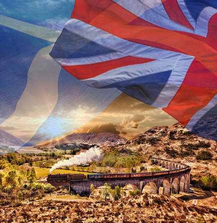 jacobite: Glenfinnan Railway Viaduct in Scotland with the Jacobite steam train against scottish ang british flags Stock Photo