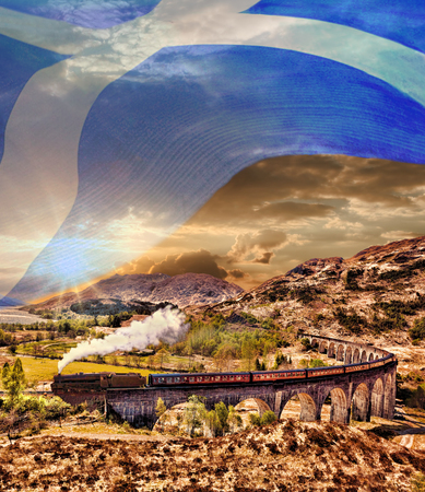 jacobite: Glenfinnan Railway Viaduct in Scotland with the Jacobite steam train with scottish flag Stock Photo