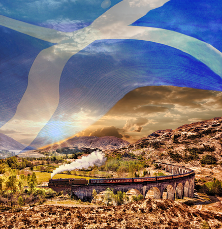 scottish flag: Glenfinnan Railway Viaduct in Scotland with the Jacobite steam train with scottish flag Archivio Fotografico
