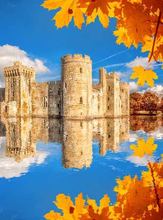 sussex: Historic Bodiam Castle with autumn leaves in East Sussex, England