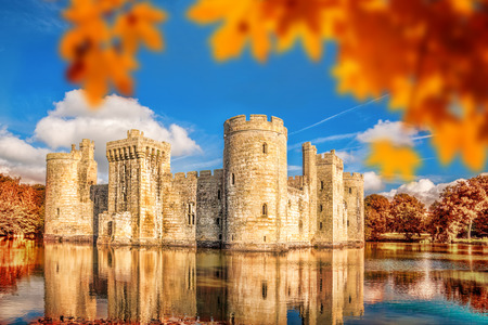 Historic Bodiam Castle with autumn leaves in East Sussex, England