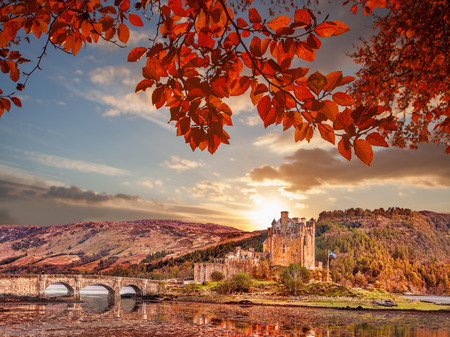 highland: Eilean Donan Castle against autumn leaves in Highlands of Scotland Editorial