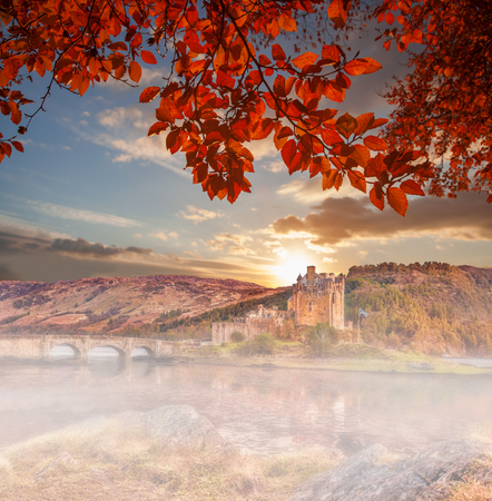 scottish culture: Eilean Donan Castle against autumn leaves in Highlands of Scotland Editorial