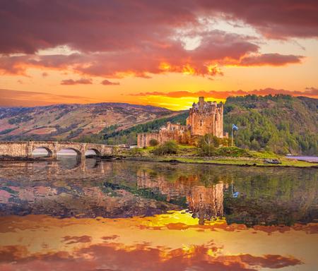 loch: Eilean Donan Castle against sunset in Highlands of Scotland