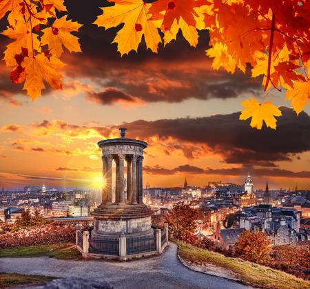 Edinburgh with Calton Hill against autumn leaves in Scotland