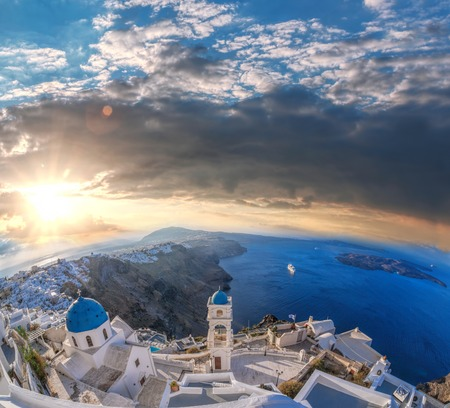 thira: Old Town of Thira on the island Santorini, famous church against colorful sunset in Greece