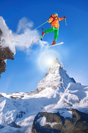 skier jumping: Skier jumping against Matterhorn peak in Switzerland.