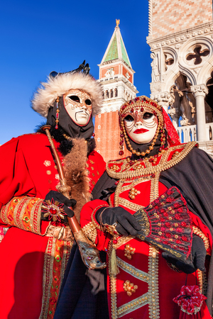 doge's palace: Carnival masks on St. Marks Square in Venice, Italy