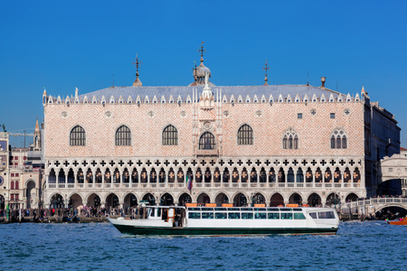 Doge palace with boats in Venice, Italy