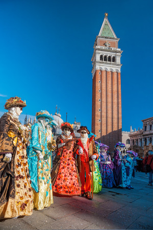 Venice with carnival masks against Marks Square in Italy